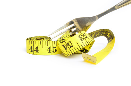 constrain: Fork and measuring tape. Dieting concept.