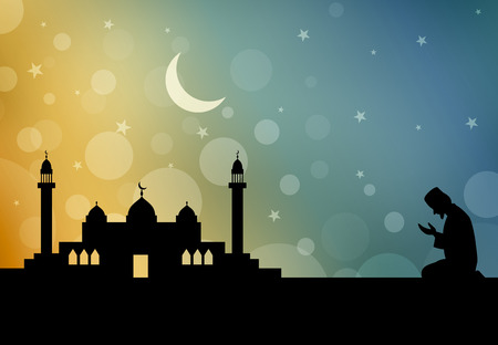 person silhouette: Silhouette of Muslim man praying on a mosque background Stock Photo