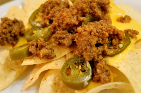 nachos with meat and jalapeno peppers