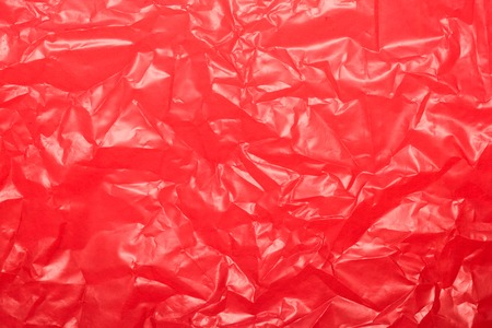 Wrinkled red plastic sheet for background or text