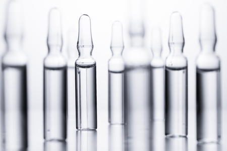 Medical ampules for injections on a white background.