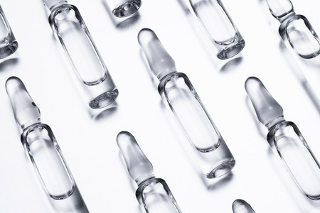 Medical ampules for injections on a white background. Reklamní fotografie