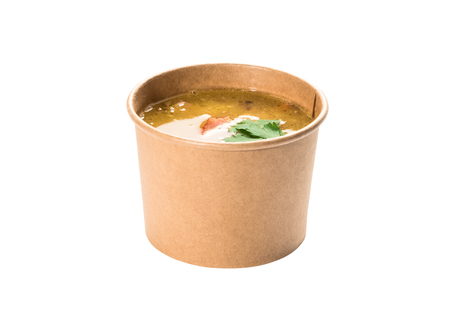 Pea soup in a disposable paper cup from craft paper 스톡 콘텐츠