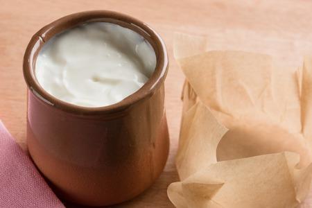 White homemade yogurt in a clay jar. Stok Fotoğraf