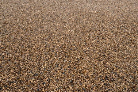 Background of fine gravel or crushed stone in perspective. Imagens