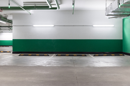 Free space in the underground parking with a green wall.