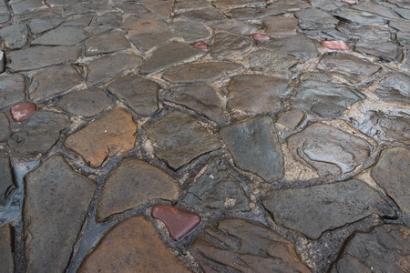 Background of natural stones. The road from the cobblestone. Imagens