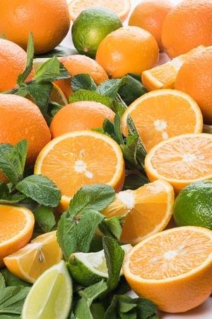 Fresh fruit, juicy slices of orange, lime and lemon with sprigs of sweet mint. Imagens