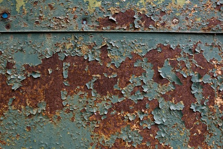 Old Rusty sheet metal with peeling blue paint Imagens