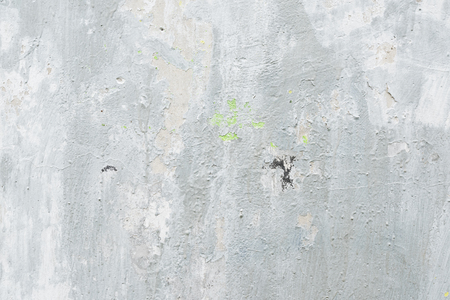 Gray textured background of old flaky plaster