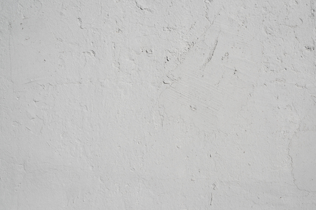 Gray textured background of old flaky plaster Imagens - 125423332