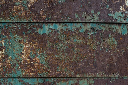 Old Rusty sheet metal with peeling blue paint Imagens - 125423334
