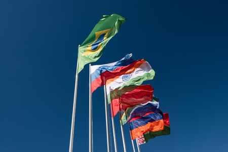 Flags of the BRICS countries in the blue sky Imagens