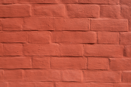 Red brick wall with smooth seams, covered with lime or plaster Imagens - 125423342