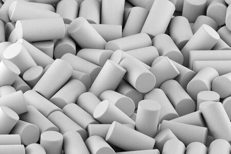 Abstract background of randomly arranged matte cylinders of white. 3d rendering