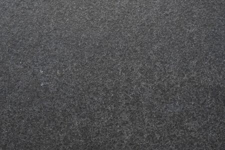 Dark granite. The texture of natural stone slabs for facing the facade of the building. Imagens
