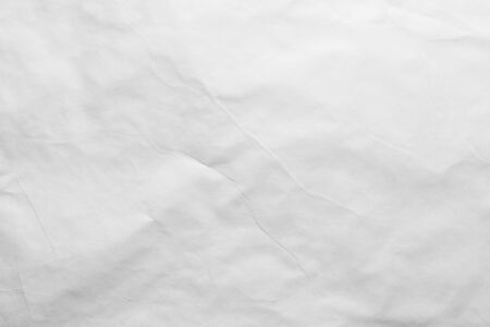 A white sheet of paper with slight bends.