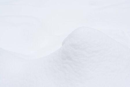 Fragment of an elegant snow dune. Christmas background.