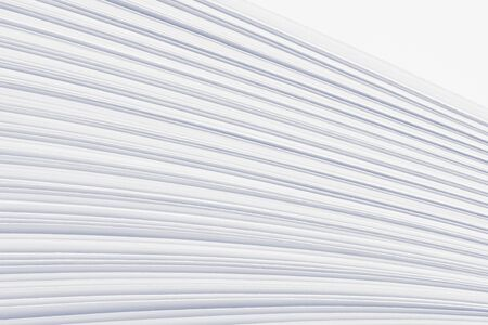 Bent stack of white paper sheets. Conceptual background of folded office forms. Imagens - 133253787