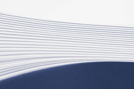 Bent stack of white paper sheets. Conceptual background of folded office forms. Imagens - 133253828