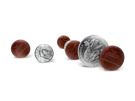 Rolling coins on a white floor Stock Photo