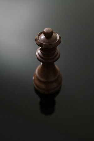 Wooden queen chess piece on a glass table. Stock fotó - 10432916