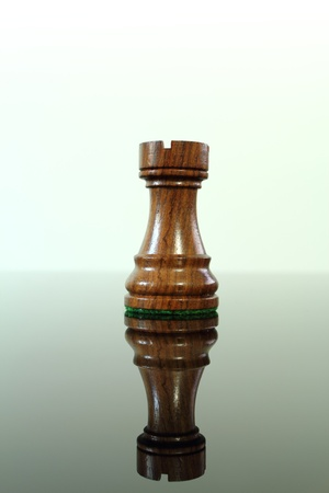 chess rook: Chess rook or castle on a smoked glass table.