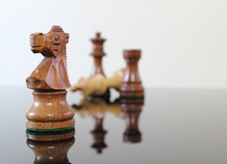 chess knight: Chess scene on a smoked glass table. Stock Photo