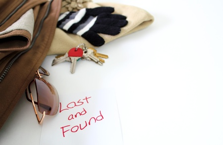 found: Various items over white to illustrate a lost and found concept. Stock Photo