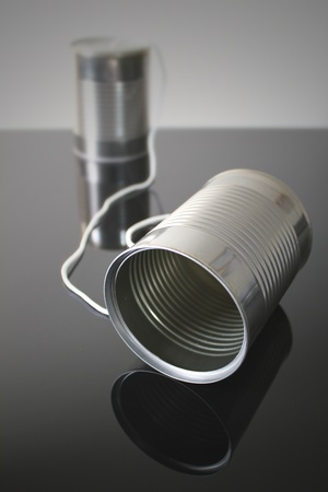 telephone: Tin can telephone with near can and far can.