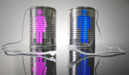 disconnection: Tin can telephone with a broken string. Male and female icons on each can respectively. Stock Photo