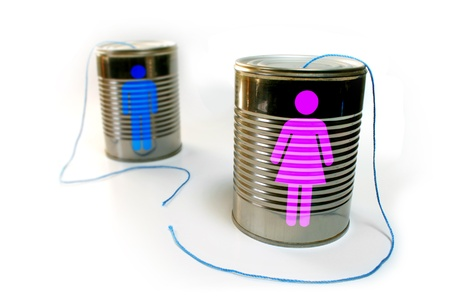tin: Tin can telephone with a broken string. Male and female icons on each can respectively. Stock Photo
