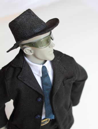 Anatomical artist manikin  dressed as a young man in a black suit with a confident stance. Stock Photo - 11813920