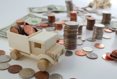 nickle: Dollar bill and coin terrain with toy construction vehicles moving money. Stock Photo