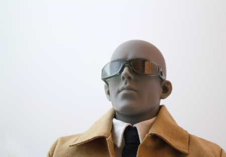 convinced: Portrait of a focused business male anatomical artist manikin with sunglasses and a coat.