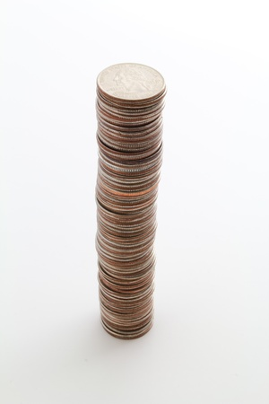 Tall stack of you US coins on white. Stock Photo