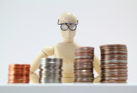 pennies: Smart looking character looking at US Coins. Stock Photo