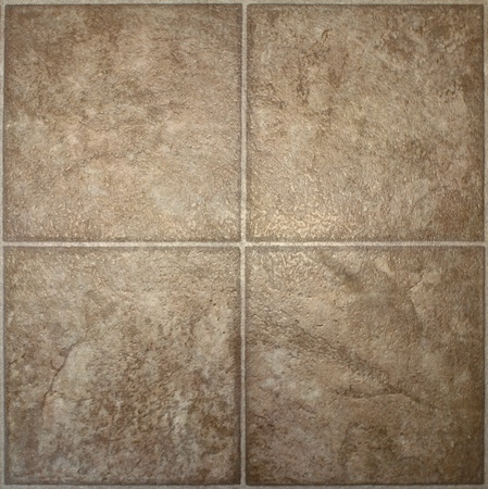 textured: Four squares of brown, textured linoleum floor tile.