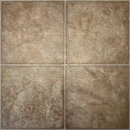 Four squares of brown, textured linoleum floor tile.