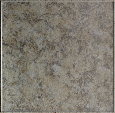 morter: Top down view of stone floor tile with marbled effect.