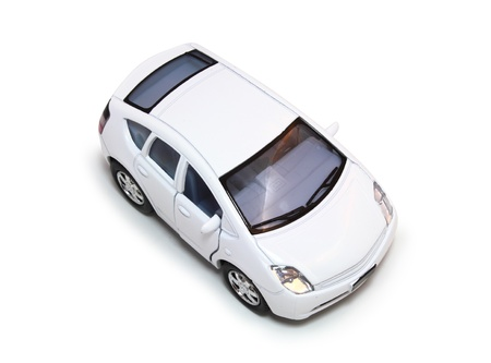 Aerial view of a white, compact hybrid car isolated on white.