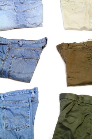 khakis: Top view of three folded blue jeans and khakis isolated on white