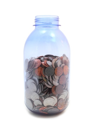 nickle: Plastic jar isolated on white with us coins inside