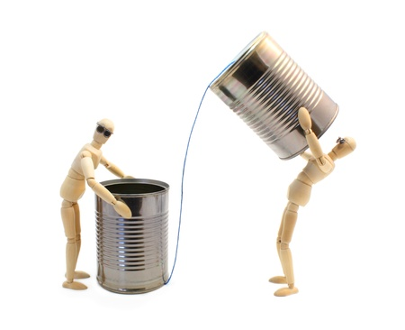 Two wooden artist manikin characters communicating through tin cans.