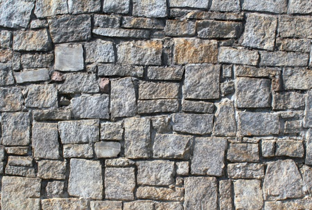 dry stone: close up of a dry stack stone wall texture.