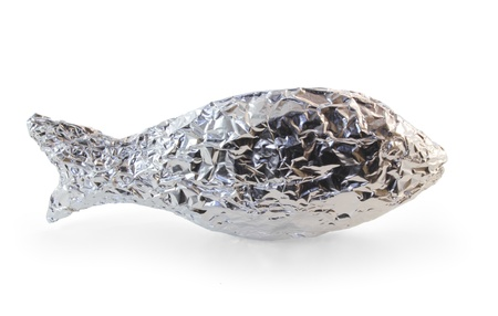foil: Frozen fish wrapped in aluminum foil isolated on white. Stock Photo