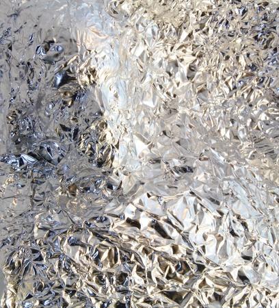 Indentedn face pressed into rough, crinckled aluminum foil. Stock Photo - 13302543