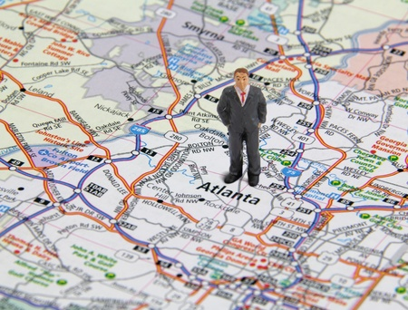 Business Man Figure Standing On A Map Of Atlanta Georgia Usa Stock Photo
