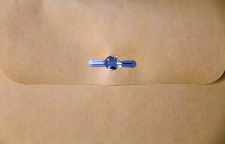 Close up of a manila envelope with metal clasp