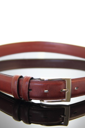 fastened: Close up of a fastened leather belt in a loop.
